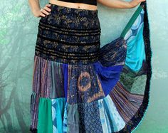 Gypsy boho fantasy long and wide skirt. Made from recycled clothing. Remade and reused. Hippie folk gypsy boho style. Perfect to gypsy dance. One of a kind. Size: M-L Waist line (uper hips I you want wear it lower) 31-40 inches (79-102 cm) stretching Hips line max 47 inches (120 cm) Length 37 inches (94 cm)