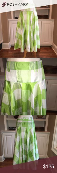 D&G Lightweight Silk Long Skirt size 28 Dolce & Gabbana long full silk skirt. It is a Green and white plaid and is full flowing to the ankles. Size 28 (42 EUR). 100% silk. It is extremely lightweight and is see through if not worn with a slip. You can wear a short slip for a sexy look with boots or be more conservative with a full length slip. It has large belt buckles so you can add a belt with a tucked in top. The skirt is in great condition. The silk has small runs and pulls which are…