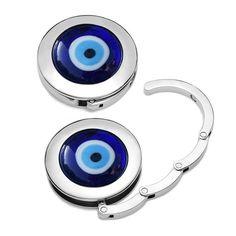 purse hook #taeshy #evileye, love it!  #baghanger #taeshy #pursehook #bagsoffthegroundwithstyle #handtaschenhalter #accessories #charms #swarovski #musthave #purse #nazar