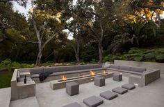 modern garden landscape outdoor seating with fire pit patio low rectangular grey stamped concrete lava rocks burner curved bench cubic