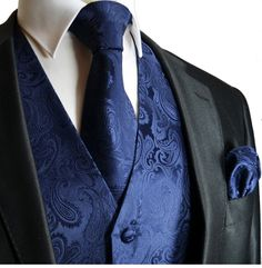 blue on blue subtle paisley tie, pocket square and waistcoat beneath simple black jacket