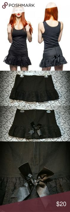 """Phaze Eva Frill Mini Skirt Goth, punk, and a little Lolita. Tagged Hot Topic, Living Dead Souls, for exposure. Brand is Phaze, UK punk brand size 12. Hardly worn. Cute bow and lace details.   Waist: 15"""" Length: 11""""   ***So much to post and so little time!! More photos upon request. I don't typically model, but I have a dress form so you can get an idea of the fit. Please know your measurements or measure a similar item of yours at home for comparison!*** Hot Topic Skirts Mini"""