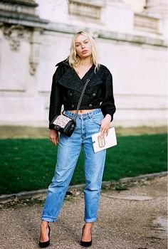 A cropped jacket worn as a top and black pumps will add a festive element to your mom jeans.