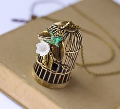 What a lovely birdcage necklace! Find it on http://www.etsy.com/listing/95942452/green-bird-vintage-style-necklace-shabby