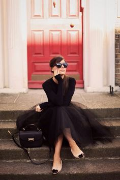 black shirt with black tulle gown