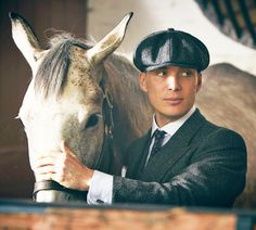 """Tommy Shelby (Cillian Murphy) in Peaky Blinders with horse """"Secret of Grace"""" before the Derby. Peaky Blinders Tommy Shelby, Peaky Blinders Thomas, Cillian Murphy Peaky Blinders, Peaky Blinders Series, Peaky Blinders Quotes, Boardwalk Empire, Triquetra, Cillian Murphy Tommy Shelby, Alfie Solomons"""