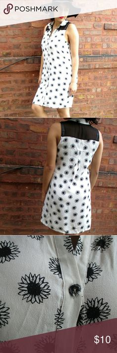 White and Black Floral Dress A sleeveless button up dress with black flowers. It's in good condition with only a little damage in the second top button (pictured above). Forever 21 Dresses Mini