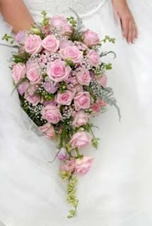 Pink rose and babys breath bridal bouquet. My Aunt Gertrude grew- blue & white babys breath in her back yard. She would do wedding bouquets on Friday nights. I would get to hold the flowers & dream.