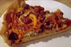 "Deep Dish Pizza from Food.com: I got this recipe from Jeff Smith, The Frugal Gourmet back in 1987. He made this recipe and ran it by Pizzeria Uno in Chicago and they smiled and nodded ""It's almost as good as ours."" This is easy, no roll recipe."