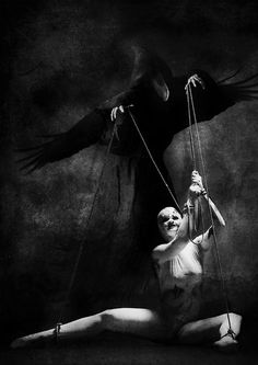 A Place for Dark Art. The puppet is the victim of ritual abuse mind control and the puppet master is the programmer or trainer.