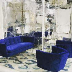 Our ELAN SETTEE & CHAIRS in royal blue velvet, against these mirrored walls, is just major! This room is killin' it propNspoon 🙌 ! Elan settee designed by Furniture Styles, Luxury Furniture, Interior Decorating, Interior Design, Decorating Ideas, Settee, Warm Colors, Home Living Room, Mirrored Walls