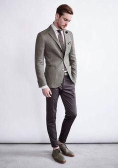 Pairing a grey sport coat and dark brown suit pants will create a powerful and confident silhouette. Mix things up by wearing olive leather derby shoes.   Shop this look on Lookastic: https://lookastic.com/men/looks/blazer-dress-shirt-dress-pants/18716   — White Dress Shirt  — Black Lapel Pin  — Brown Tie  — Grey Blazer  — Dark Brown Dress Pants  — Olive Leather Derby Shoes