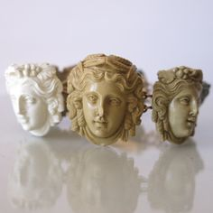 An Antique Victorian Gold and Lava Cameo Bracelet.