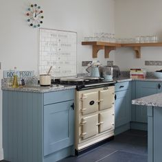 and cream Aga kitchen Blue and cream kitchen with AgaBlue and cream kitchen with Aga Aga Kitchen, 1920s Kitchen, Kitchen Corner, Kitchen Decor, Kitchen Ideas, Kitchen Cabinets, Cream Aga, Country Kitchen Designs, Country Kitchens