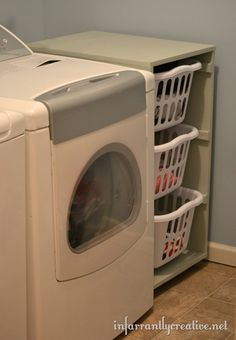 I like the idea of having a (larger) laundry basket area next to the drier, with a shelf for folding that is the same height as the drier.