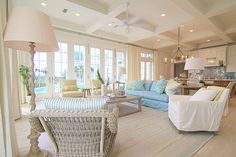 Whitewash slipcover living rooms with pastel acccents and shaby chic design have a coastal winter feel. Winter whitewash coastal living rooms that inspire the crew at Our Boat House. House Of Turquoise, Beach Cottage Style, Beach House Decor, Coastal Cottage, Coastal Decor, Style At Home, Coastal Family Rooms, Florida Home, Home And Deco