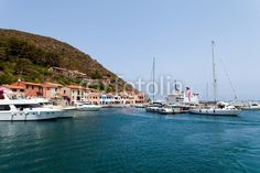 Stock photo available for sale at Fotolia: The Port Of Capraia Island, Italy