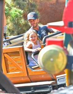 Faster, daddy! The mini fashionista is clearly taking after her brothers and is already proving to be a little daredevil