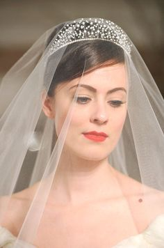 Romona Keveza pairs a simple wedding veil with a delicate crown resembling baby's breath.
