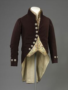 Court Suit: By the decade 1810 to 1820, men's court dress was becoming more subdued in colour and decoration. Once made of a lavishly embroidered silk or velvet, court coats of this decade were a dark-coloured wool, much like fashionable day wear. The colourfully embellished waistcoat characteristic of 18th-century court dress remains, retaining its old-fashioned 'skirts' and pockets.