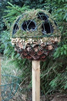 This home made bug ball topiary is a good example.  Encased in the wire dome you'll find pine cones, bamboo, some grasses, and various pots.  Bug Ball Topiary - fill pots  with  an array of wildflowers designed to attract and feed butterflies and bees.