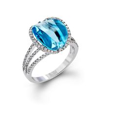 This unique 14k white gold ring is a part of our Refind Rebel collection and contain a 5.58 ct blue topaz and .34 ctw of white diamonds.