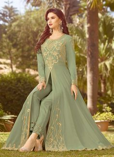 Light Green Golden Embroidered Slit Style Anarkali Suit will indulge you to look more beautiful on this wedding season with its alluring beauty. This set comprises of ethnic zari and resham-kari embroidered slit style fancy georgette top Pakistani Dresses Casual, Indian Gowns Dresses, Indian Fashion Dresses, Dress Indian Style, Pakistani Dress Design, Indian Designer Outfits, Fashion Outfits, Flapper Dresses, Emo Fashion