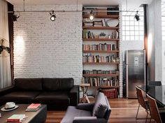 modern and industrial loft. love the white brick wall.