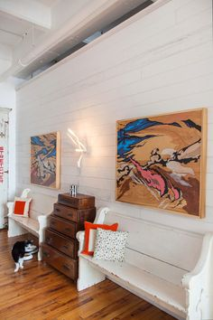 """Sneak Peek: An Eclectic Philadelphia Loft. """"The white church pews in the hallway were from the church my parents got married in. The paintings are from local artist Kyle Fisher. The stacking dresser is mine on loan from a dear friend who lives in Amsterdam – Leslie Oschmann . It was her grandmothers…but I still never want to give it back."""" #sneakpeek"""