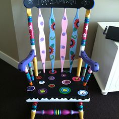 A funky rocking chair made for a teacher. The top is chalkboard paint so the teacher can write anything she wants! :)