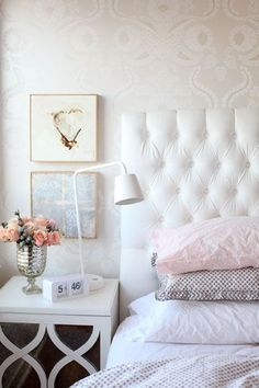simple muted colors with metallic accessories...I like the metal vase and the bedside table with mirror surface