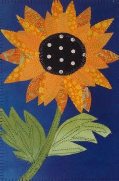 Sunflower. Oh, a wall hanging for sure!