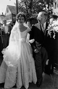 Jackie Bouvier (the future Mrs. John F. Kennedy) being escorted to the church by her stepfather Hugh Auchincloss. (Newport, Rhode Island 1953)