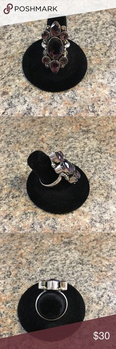 Sterling Silver African Amethyst Ring-Size 9 Sterling Silver African Amethyst Ring.  Size 9.  This ring is not marked 925, but has been tested to be Silver!  The stones are all bezel set so they won't catch on your clothes!    I hope you enjoy this fun ring!  Thank you for viewing my listing!  Happy Shopping! Jewelry Rings