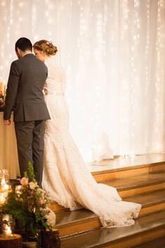 Stunning and elegant January winter barn wedding close to Salem, Oregon. Twinkle light backdrop