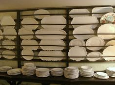 A large wooden plate rack in the hip Parisian accessories store called Astier de Villatte, shows how effectively dark wood contrasts with white dishware. Racks like this one, set over a shelf or console table, are often found in Swedish manor house dining rooms.