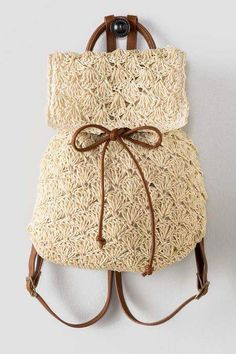 Discover the hottest trend of the season! The Claudia Crochet Backpack is light and airy making it the perfect bag for the summer.straw crochet backpack features an interior pocket, adjustable brown straps, a drawstring Baby braids newest knitting pattern Crochet Handbags, Crochet Purses, Bead Crochet, Crochet Baby, 2 Baby, Knitting Patterns, Crochet Patterns, Crochet Backpack, Macrame Bag