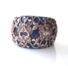 Masha Archer Original Artist Massive Bangle Silver cutwork Blue resin Ret $1875! #Bangle selling for less than 50% off. Also, two more pieces by this incredible, renowned artist. Follow the link to my ebay listings and see. http://www.ebay.com/sch/stylishgear/m.html?item=161230701891&ssPageName=STRK%3AMESELX%3AIT&rt=nc&_trksid=p2047675.l2562