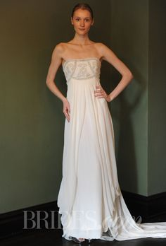 """Brides.com: Great Gatsby-Inspired Wedding Dresses. """"Crystal Mirage"""" strapless sheath wedding dress with draped skirt and beaded bodice, Temperley Bridal"""