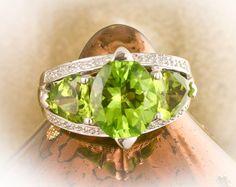 14k WG Oval Peridot Diamond Ring Two Heart Shaped Peridots each side, White Gold Diamond Ring with Oval Peridot and Heart Shaped Peridots by GoldleafJewelers on Etsy https://www.etsy.com/listing/115733245/14k-wg-oval-peridot-diamond-ring-two
