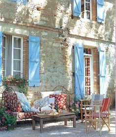 Gravel patio with great old iron daybed...