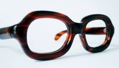 Massive organic spectacle frame in dark faux tortoiseshell acetate from General…