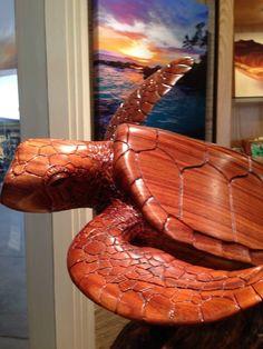 Hawaiian Honu carved in solid Koa by Hawaii craftsman Craig.  At our store at The Shops at Wailea.