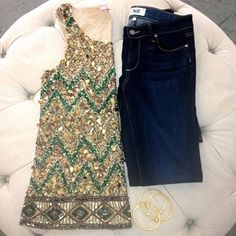 embellished top with dark denim, tufted ottoman in closet