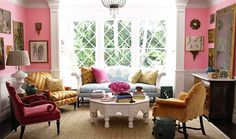 Colorful living room with patterned chairs and sofa // pink walls
