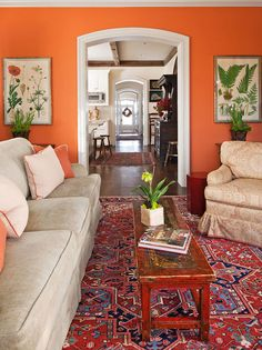 from http://eclecticrevisited.com  I love the idea of orange walls