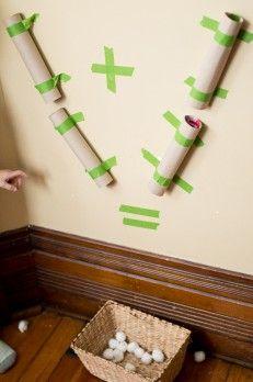 A visual addition activity using a pom pom drop