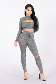 - Available in Heather Grey - Matching Set - 80% Rayon 16% Polyester 4% Spandex Top - Long Sleeve Crop Top - Mock Neckline - Front Cut Out Bottom - Leggings - Elastic Waist Band - Knee Slits