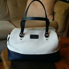 Grove Court Lainey *Use offer botton ONLY and *No lowballs- Never carried, dustbag and all original tags still attached. **This style was not designed with a crossbody strap. Cream/Navy pebbled leather, double handled, 2 zip compartments and one large center with magnet closure. kate spade Bags