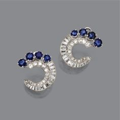 PAIR OF SAPPHIRE AND DIAMOND EARCLIPS, CIRCA 1945. The semi-circular motifs set with 8 round sapphires at the borders, completed by 36 baguette and 26 round and single-cut diamonds together weighing approximately 1.75 carats, mounted in platinum.